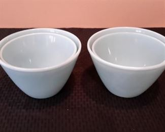 Two sets of vintage Fire King azurite nesting mixing bowls.