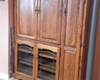 Oak entertainment center with tons of storage.