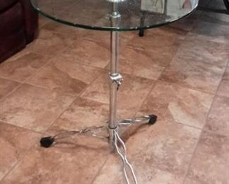 Unique glass table with drum stand legs...adjustable!