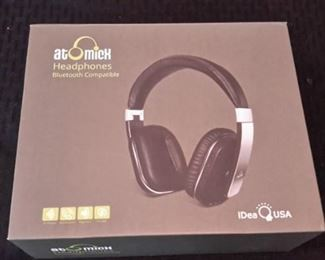 Atomick Headphones, like new, in box.