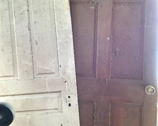 Wooden doors also have several windows