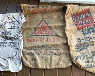 Several old feed sacks cloth and burlap