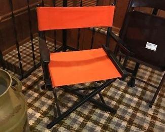 4 nice UT orange foldable chairs