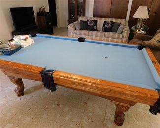 Game room classic billiard table, with all the accessories. Cues, cue rack, balls, ball rack, chalk etc.