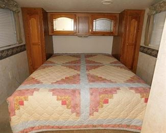 Queen bed in the front with ample storage.