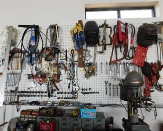 One wall of small tools and misc