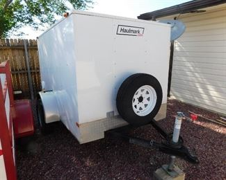 Haulmark 5' x 7' enclosed trailer with spare tire with inside power source.