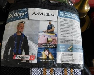 Automatic inflatable PFD by Onyx. Gas charged. Brand new.