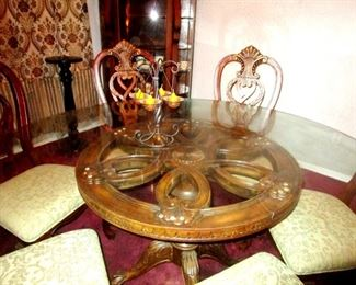 Giant glass top table with solid wood pedestal and eight chairs