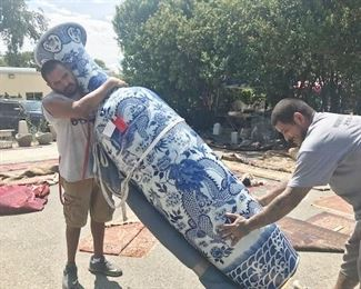 Ruben and George move on of two giant Chinese vases sold on Saturday. Check the rugs in background. Cheap prices.