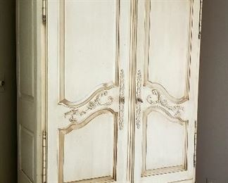 Antique white one drawer base armoire