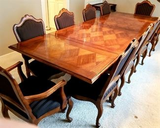 Beautiful drop leaf inlay dining table has ten upholstered chairs including two host's - pristine condition