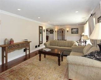 Couch, love seat, coffee table, lamps, console table.