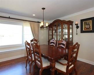 Dining room table (with extension leaves), 8 chairs, hutch,  sideboard.