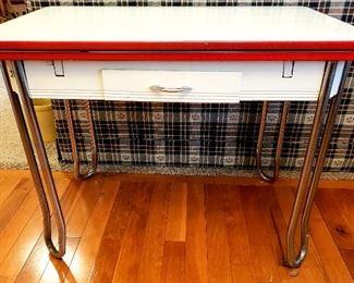 Porcelain top vintage table with chrome legs