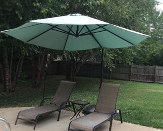 Very nice lounge chairs and huge patio umbrella