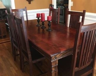 Look at the wood on this dining room table with 6 chairs