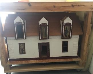 This is a custom built antique dollhouse, this was built in 1903, is is the exact replica of the home the Grandmother lived in