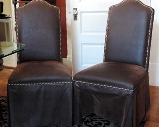 PAIR OF LEATHER UPHOLSTERED PARSONS CHAIRS WITH STUDS