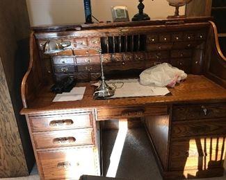 Solid oak roll top desk, excellent condition.