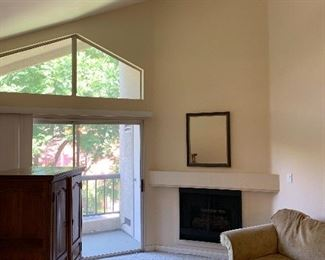 Vaulted ceiling living room with gas fireplace