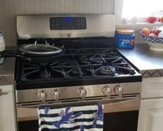 Kenmore Elite Gas range; Kenmore microwave oven mfg. 10/04