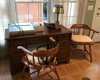 Desk and captain's chairs