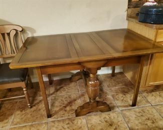 Folding Table....Antique.  Much like me.  Still got my legs, still standing, but I am old.  Ol Lord, can somebody call 911