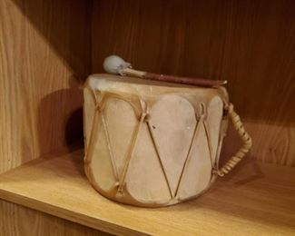 Drum..  Good gift for the new parents that you don't like