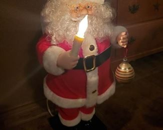 Santa Lights up and sings.