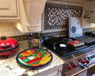 Pizza maker and stones, platters and stainless pots and pans