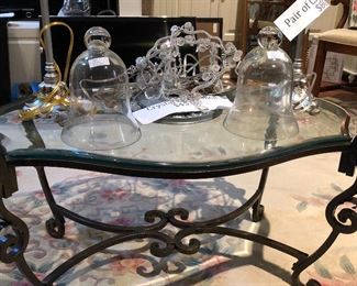 Cloches.  Glass top and Wrought iron.  Crystal chandelier. Oriental rug.