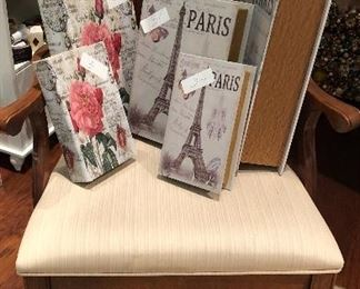 A single Chippendale side chair.  Some fun Paris boxes.