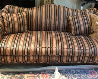 This picture does not do this sofa justice.  Hump backed Chippendale legs. Beautifully upholstered. and two pillows.