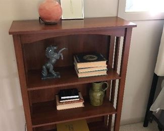 wood bookcase and objects of art