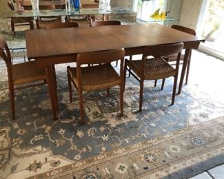 Teak dining table - mid-century with 12 chairs (10 side and 2 arm) - by Povl Dinesen, and large wool area rug