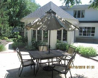 Beautiful tile patio table and umbrella