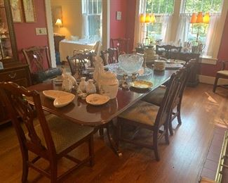 Knob Creek cherry dining table with two leaves and 4 pads, 8 side chairs and 2 arm chairs