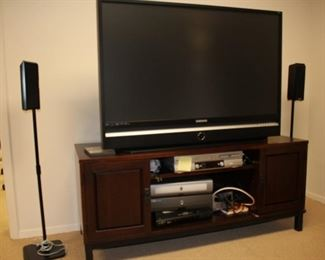 Large Flat Screen TV, Media Shelf, and Pair of Speakers