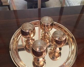 Silver plate set of wine glasses.