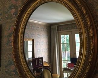Oval gilded mirror.