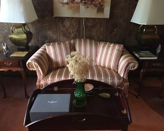 Striped love seat, captains table, end tables and lamps.