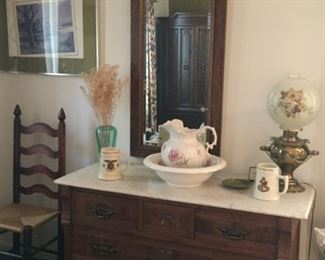 Marble top cabinet and assorted accessories.
