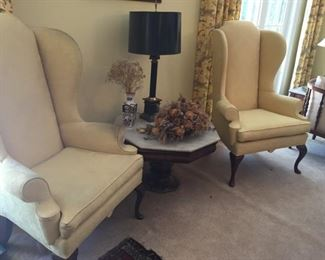 Matching armchairs, lamp and octagonal table.