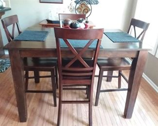 Great counter height table and four chairs with built in leaf