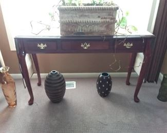 Sofe/entryway table with 3 drawers (planter not for sale).