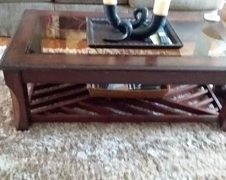 Great condition glass top coffee table with decorative horn like piece