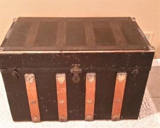 Vintage trunk with smokey glass top.
