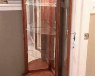 Lighted solid oak curved glass corner curio with lock and key (not all contents for sale).