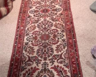 Hand knotted wool runner in great condition. There are two of these, slightly different color and patterns.